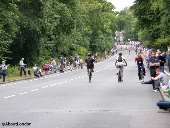 Local cyclists entertained the kids, while we were waiting, by doing wheelies.down the quiet road
