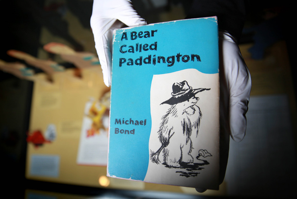 Curator Hilary Young prepares a signed first edition of the first ever Paddington story called A Bear Called Paddington. Image credit: Matt Alexander/PA Wire