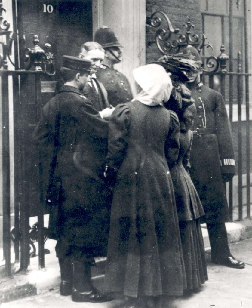 Suffragette human letters being delivered to 10 Downing Street in 1909.