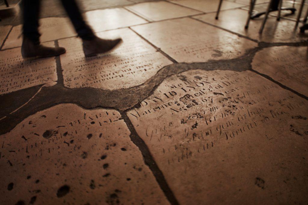 Café in the Crypt gravestone flooring